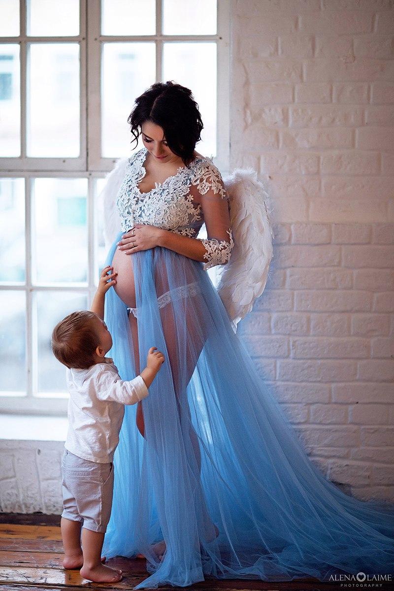 Фотосессия беременности в крыльях