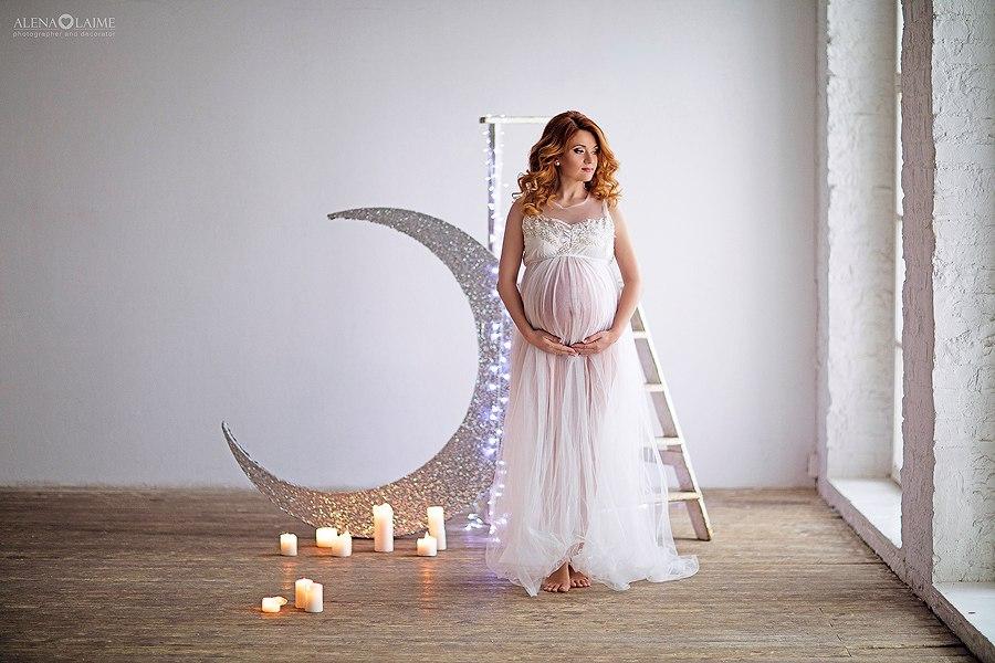 Фотосессия беременности со свечами