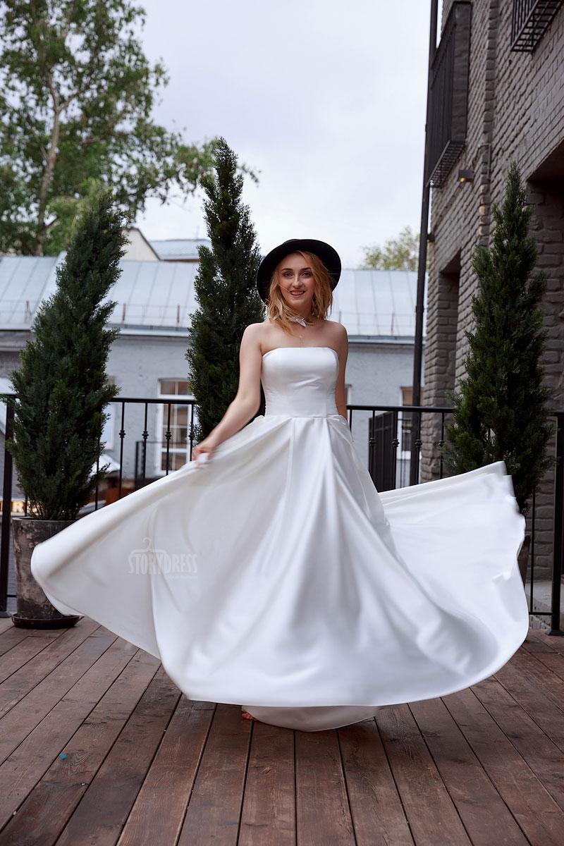 Свадебное платье из ткани, держащей форму
